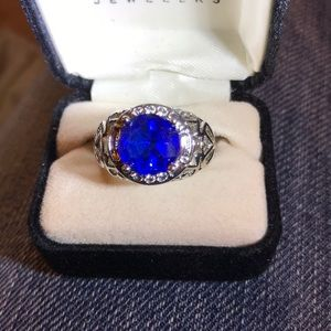 Silver and lab created blue sapphire ring. Size 7.